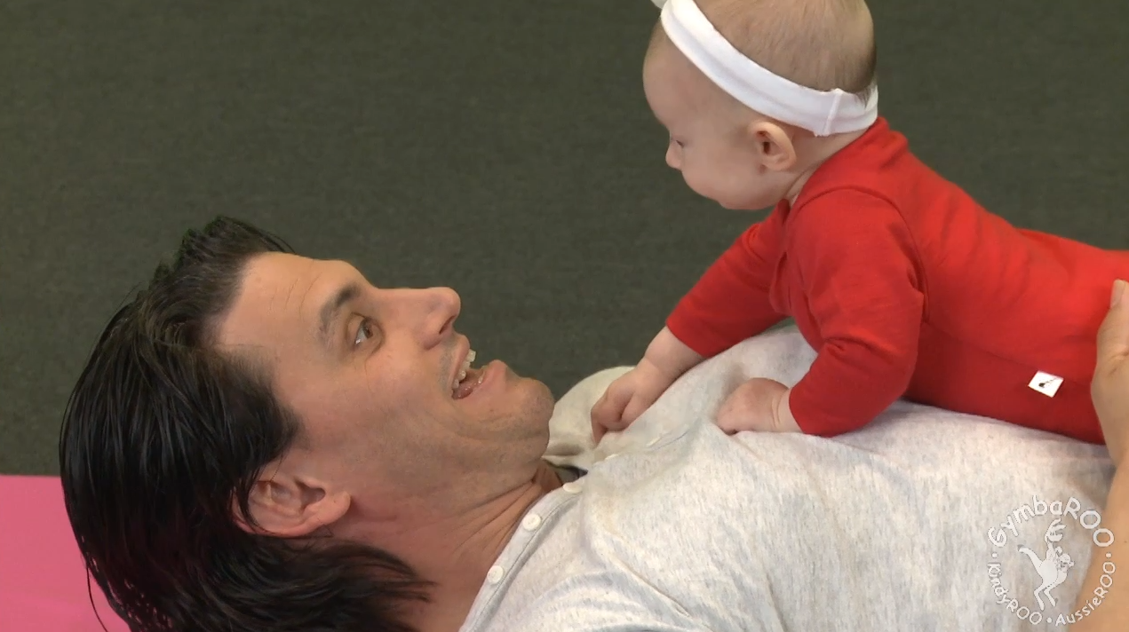 baby doing tummy time with dad. BabyROO GymbaROO Active Babies Smart Kids free online videos