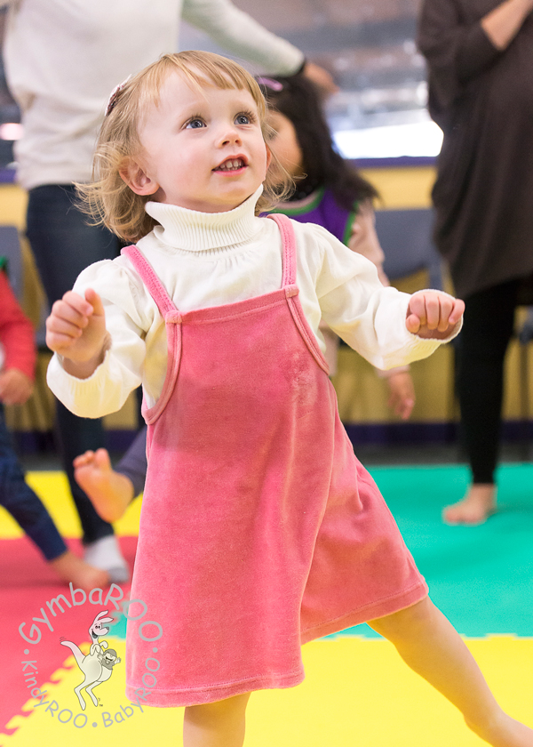 Happy child exercising at mat time at GymbaROO