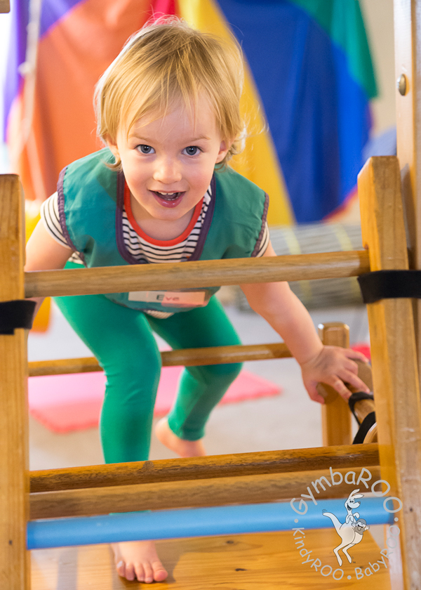 GymbaROO child learning coordination and balance on the equipment